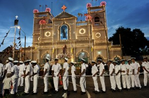 SRI LANKA. The Navy provide a cordon around the vehicle which will carry the statue of St. Anthony around the neighbourhood. .Kochchikade, Colombo 13. Last day of the annual feast and festival.